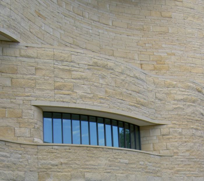 window in curved stone wall
