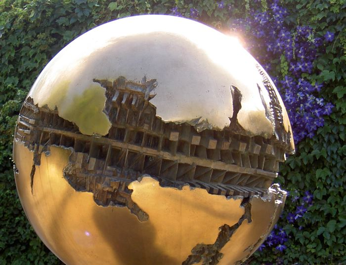 gold sphere against flowers