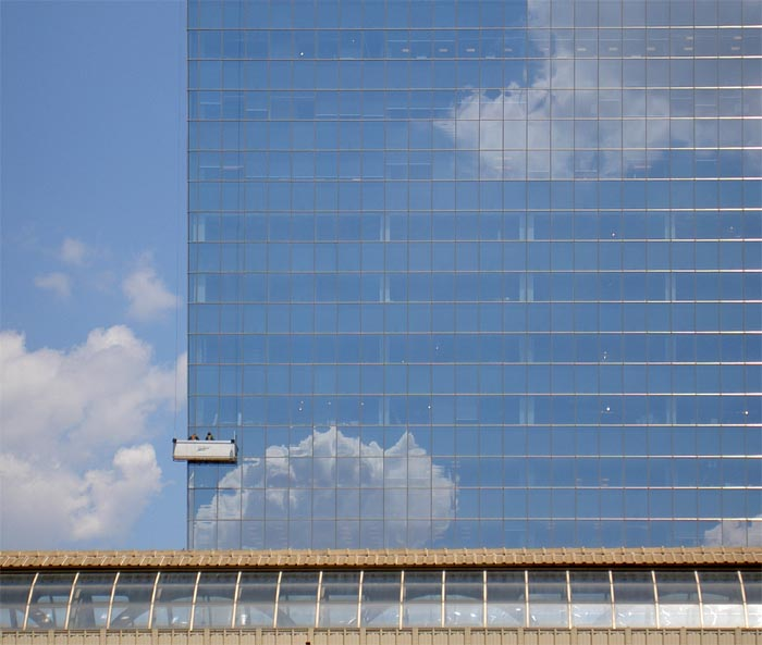 window-cleaners on the Cira Centre, as seen over 30th Street Station