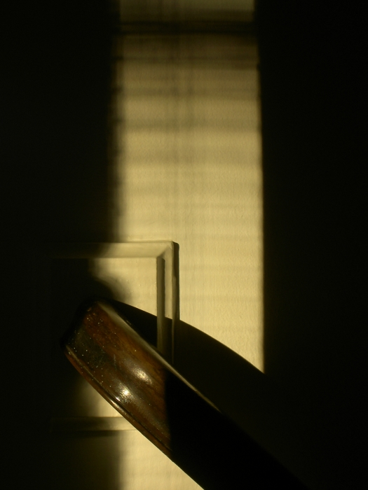 evening light on a stair rail
