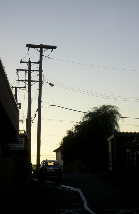 evening silhouettes along a narrow street