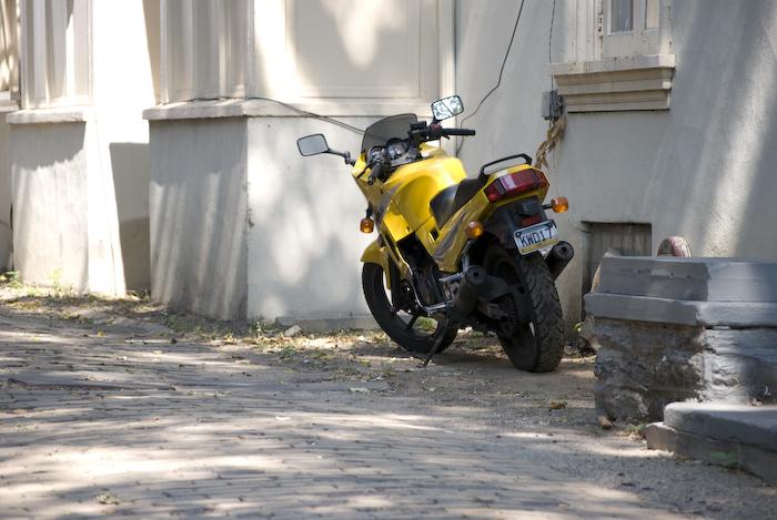 motorcycle parked in an alleyway off locust walk