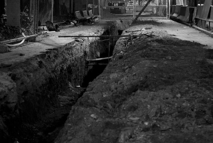 a trench near Addams fine arts hall, at night