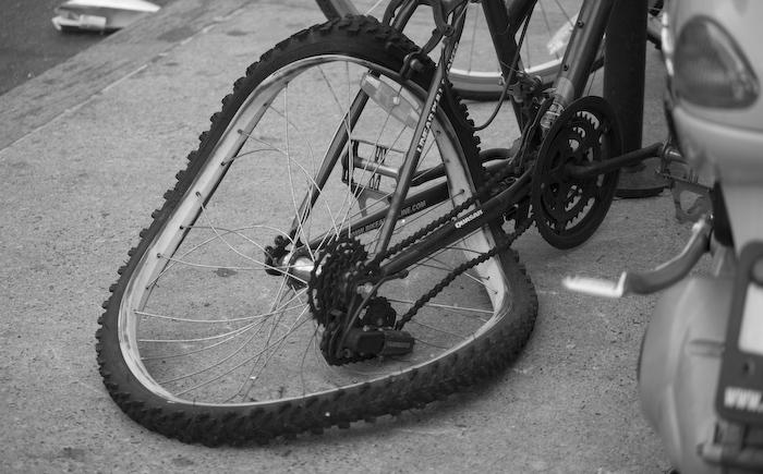 a bike wheel, bent sideways