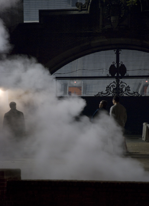 steam from vents by Franklin Field, partially obscuring figures