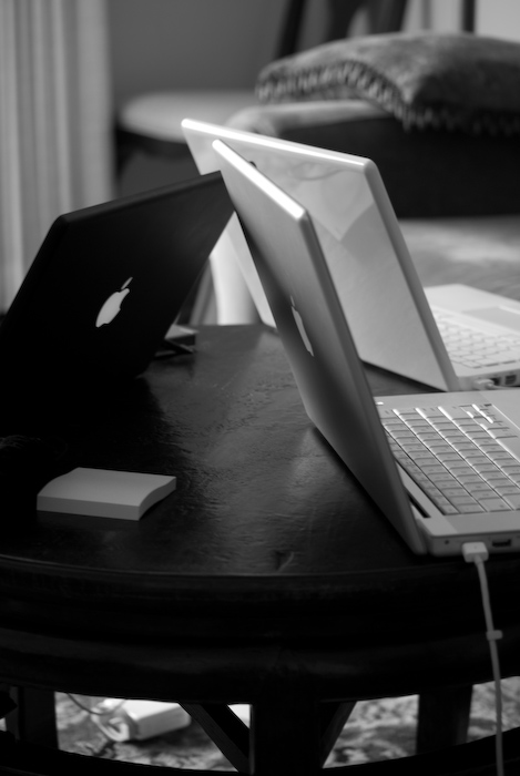 laptops clustered on a coffee table