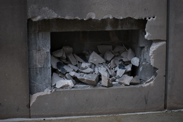 hole in an exterior wall filled with rubble