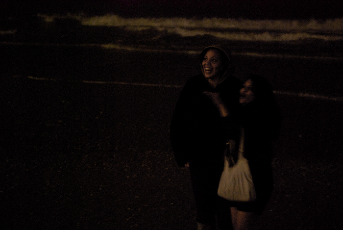 people on the beach at night