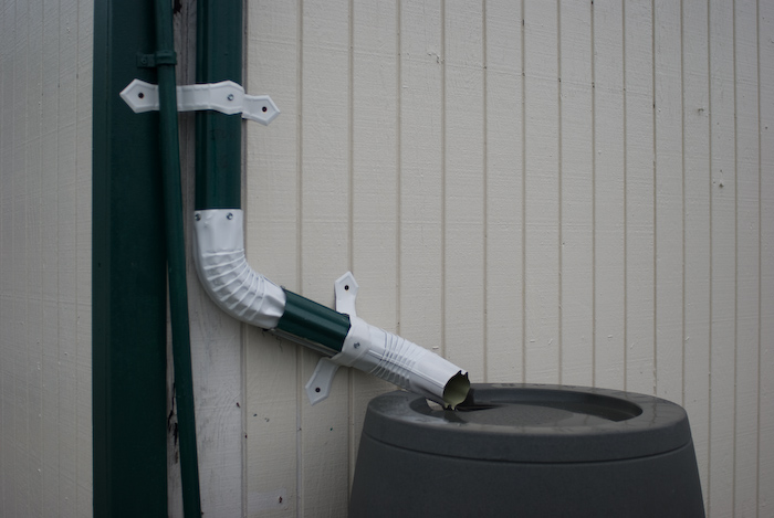 downspout and rain barrel, green and white paint