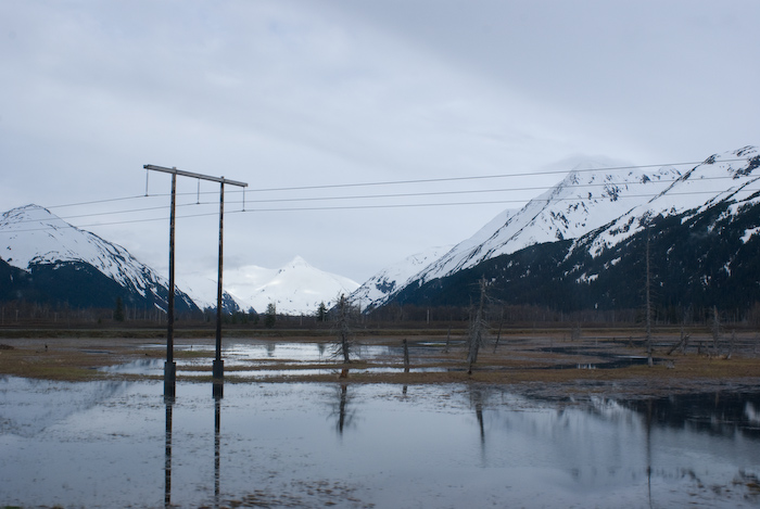 mountain reflected in water, with power line