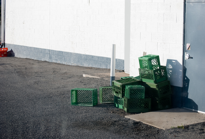 green crates against a wall