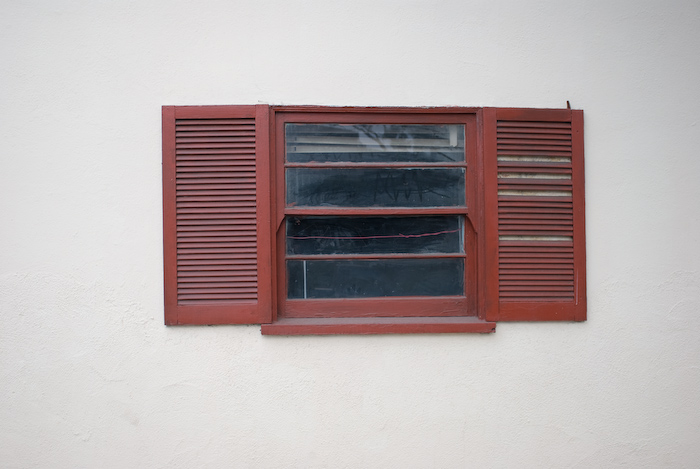 red window with red wire in white wall