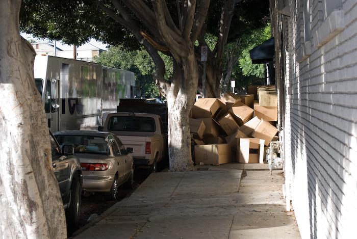 box cascade across sidewalk with strucks