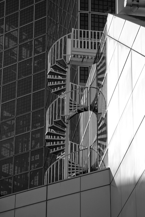 spiral staircase on exterior of metal and glass building
