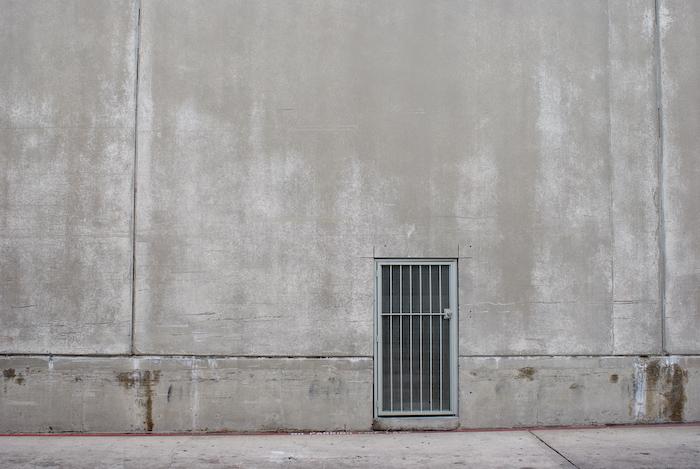 grating door cut in concrete wall