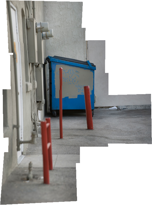 red pipes in front of blue dumpster, long lens photomerge