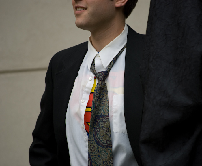 man in clark kent costume, with superman symbol showing slightly