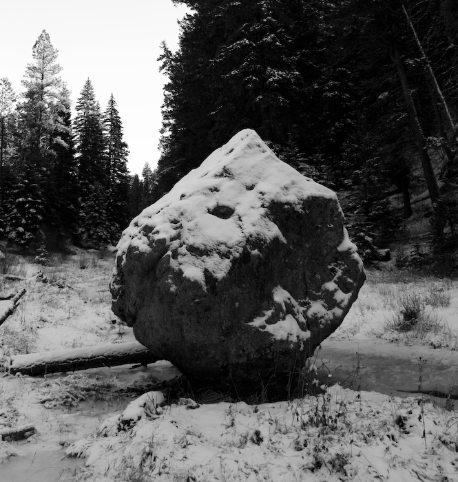 pointed boulder isolated in river