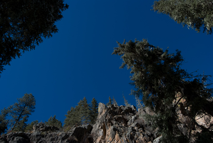 sky surrounded by cliff and trees