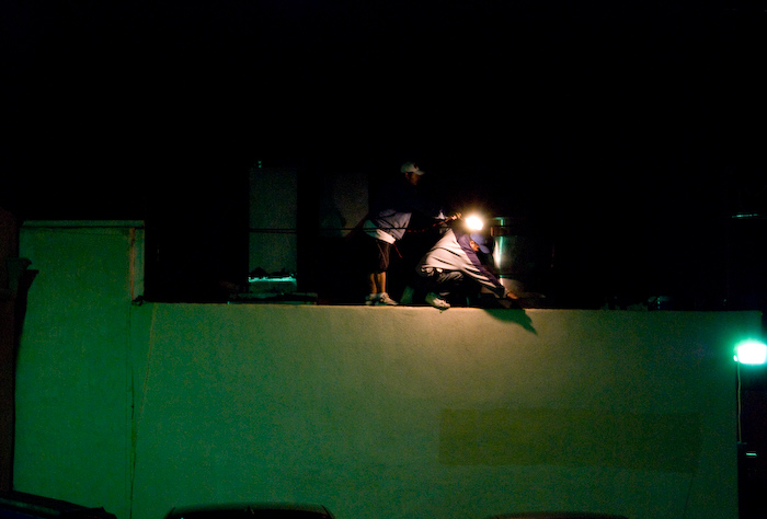 workers on a roof at night