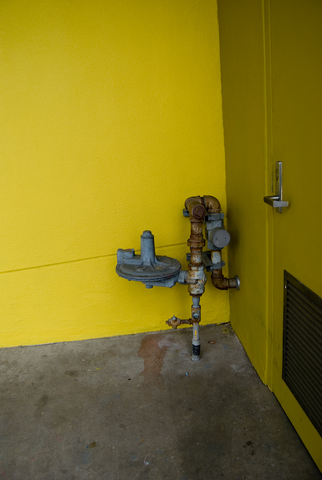 pipes in yellow exterior corner