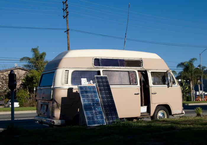 van in sun with solar panels