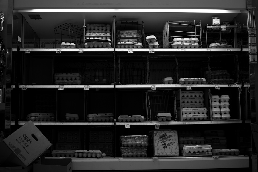 partially empty shelves of eggs