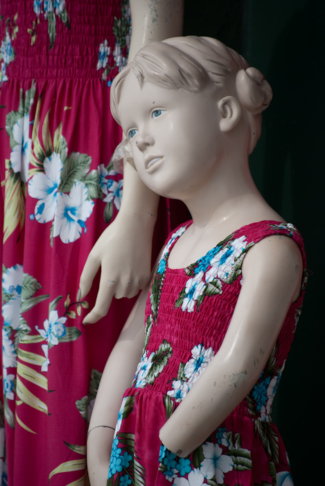 mannequin child and woman in matching clothes with missing appendeges