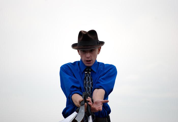 performer holding juggling knives