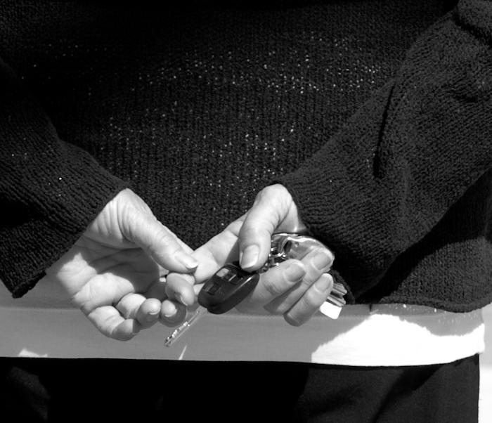 hands and keys of a pedestrian