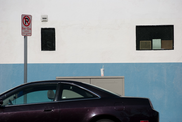 purple car, sign, and wall with windows