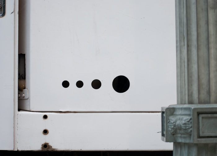 circular cutout holes on the side of a truck