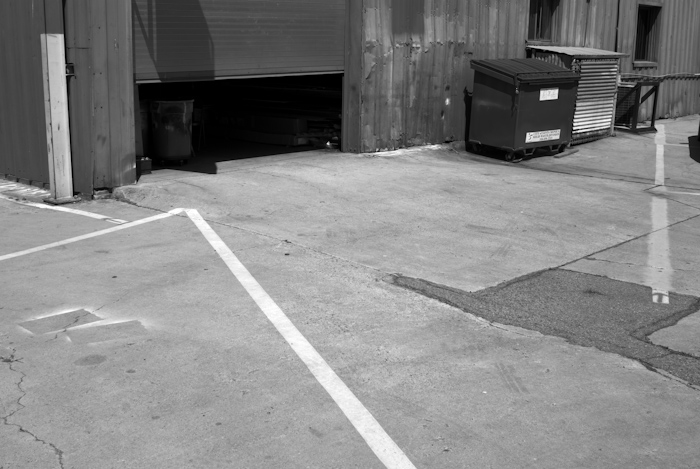 parking lot with partially open garage door
