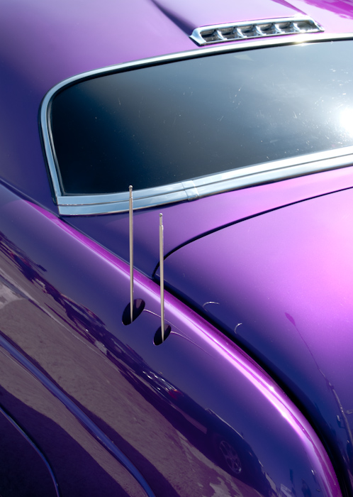 back of purple car with antennae
