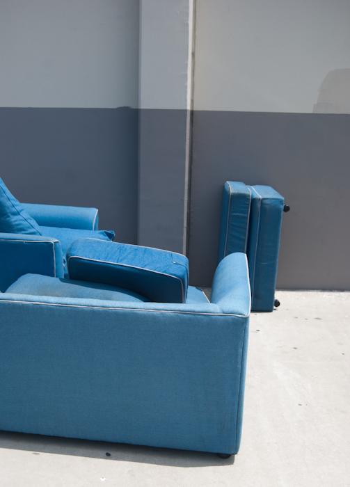 blue sofas on sidewalk