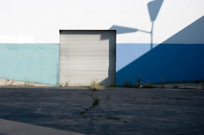 garage door with wall and blue stripe and lamp shadow