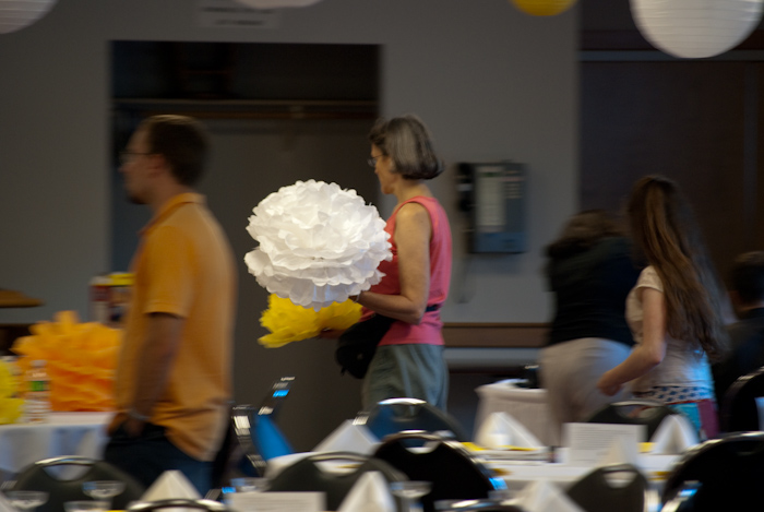 woman carrying paper flower with motion blur