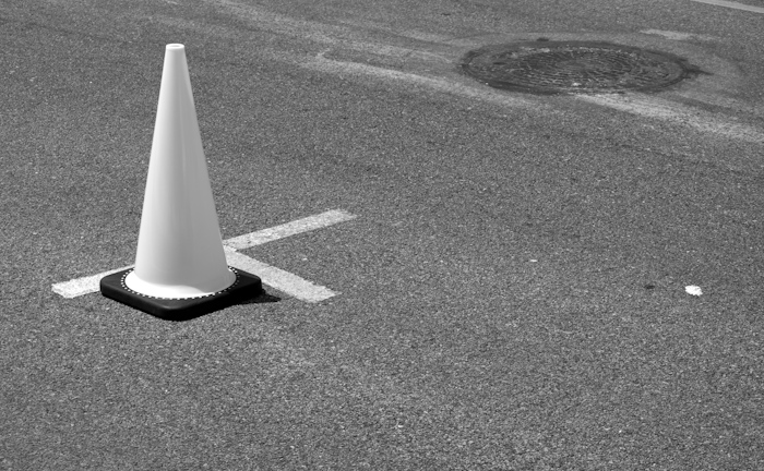 traffic cone with dotted base in street