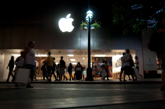 apple store at night with man in wheelchair