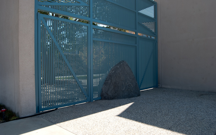 rock in bars at edge of courtyard