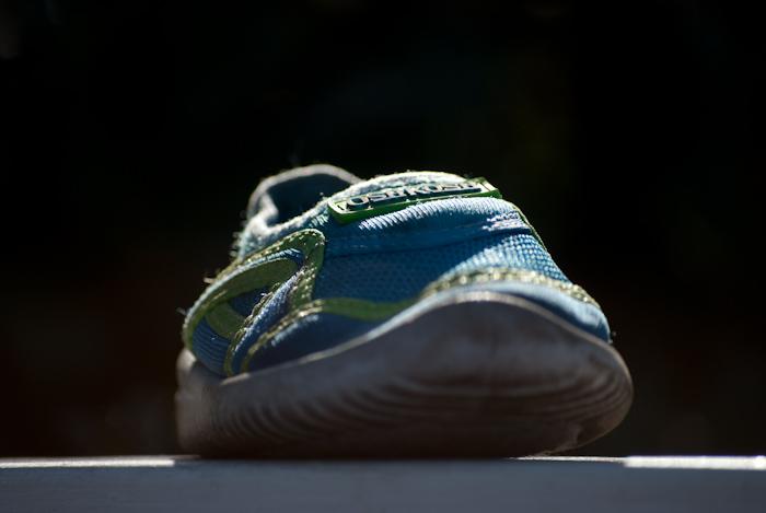 baby shoe backlit on wall