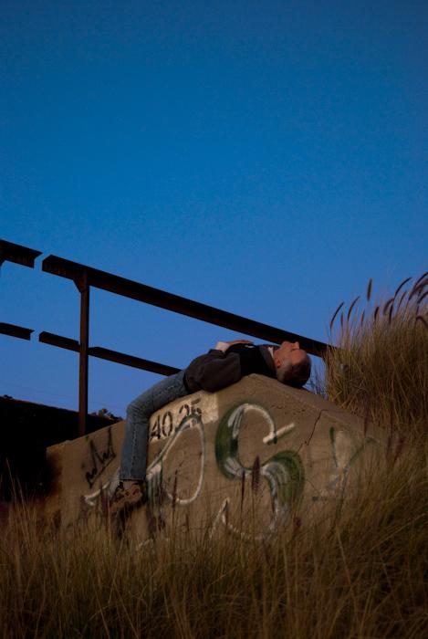 lying on back on embankment