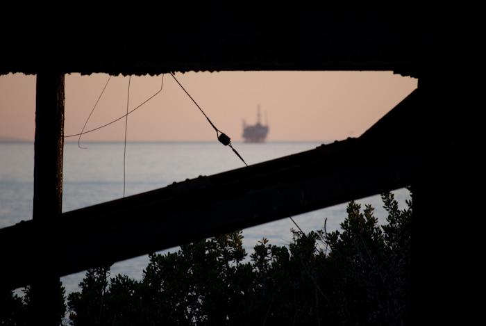 oil rig past bridge structure silhouette