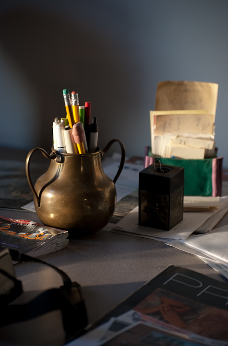 brass pencil holder on desktop