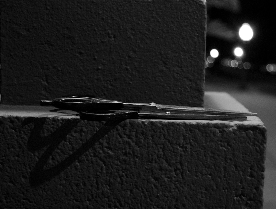 scissors on ledge at night