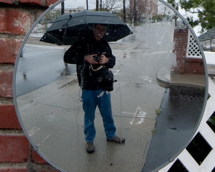 Mark under umbrella in convex mirror
