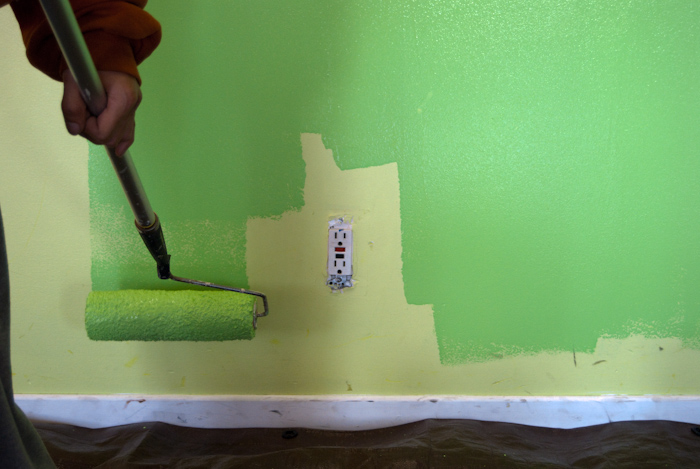 roller, green paint and outlet