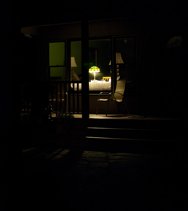 desk with light behind porch at night