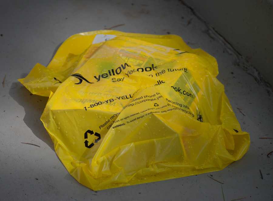phone book in bag on gray, wet