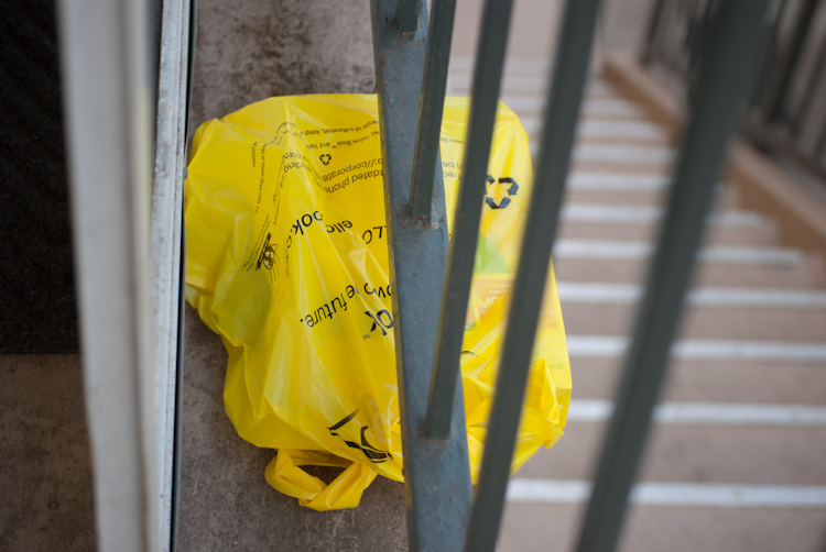 phone book in bag under stair rail